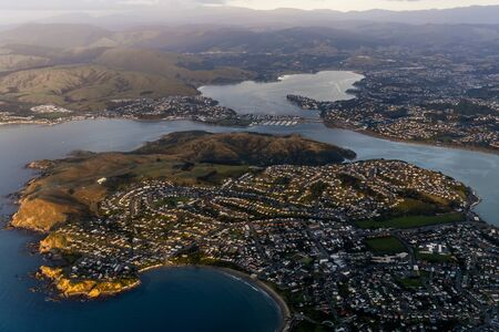 Aerial View from an Airplane Window flying over wellington, New Zealand Фото со стока