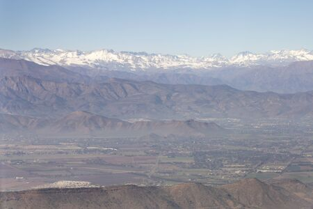 Aerial view of the Andes mountain range through the window of an airplane from Chile