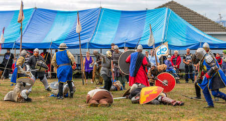 Levin, New Zealand - February 10, 2018: Reenactors battle at a medieval market in Levin showgrounds, New Zealand.