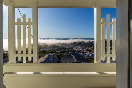 A view from the wooden terrace of a foggy day in Wellington, New Zealand