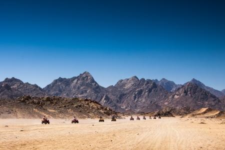 Safari Tours by quad bike in Egypt  Tourists riding quadbikes in desert
