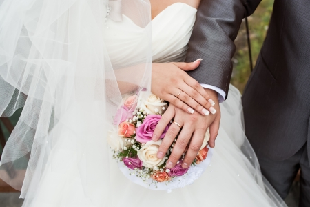 Wedding photograph of a young couple of lovers who are just married, are close to each other in harmony, love and happiness  photo
