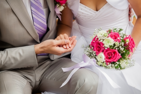 proximity: Wedding photograph of a young couple of lovers who are just married, are close to each other in harmony, love and happiness.
