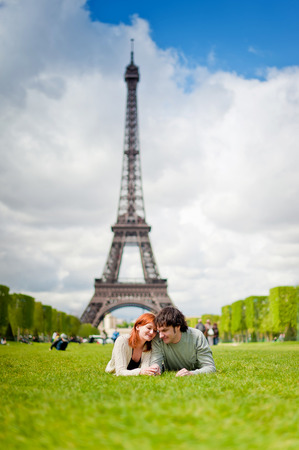 romantic places: Lovers kissing in Paris with the Eiffel Tower in the Background Stock Photo