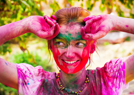 DELHI, INDIA - MARCH 20: Tourist with students of Jawaharlal Nehru University celebrate festival Holi on March 20, 2011 in Delhi, India. Holi is a spring festival celebrated as a festival of colours. 스톡 콘텐츠
