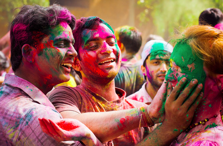 DELHI, INDIA - MARCH 20: Tourist with students of Jawaharlal Nehru University celebrate festival Holi on March 20, 2011 in Delhi, India. Holi is a spring festival celebrated as a festival of colours. 에디토리얼