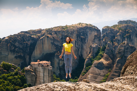 kalambaka: Beautiful tourist in Greece with the Meteora Monasteries in the background