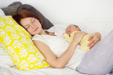 3 6 months: Newborn baby sleeping in the hands of his mother Stock Photo