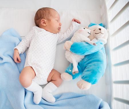 3 6 months: Newborn baby sleeping peacefully in the crib