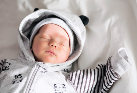 only 3 people: Newborn baby sleeping peacefully