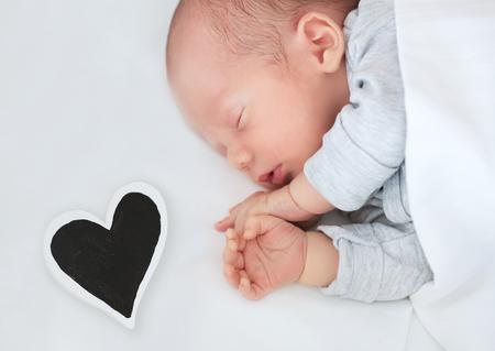 3 6 months: Newborn baby sleeping peacefully