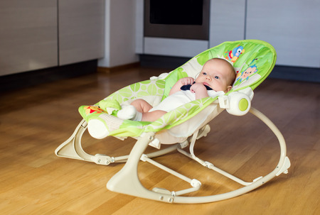 rocking chair: Peaceful baby in the rocking chair at home