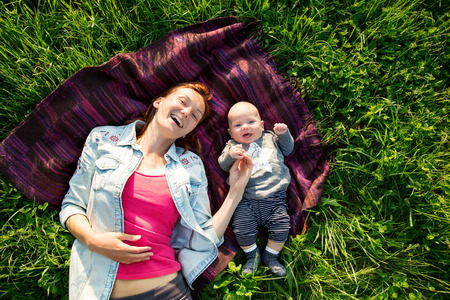 mother baby: Baby and mother on nature in the park