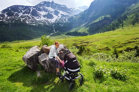 3 6 months: Baby and mother with the Alps mountains in nature in the Background