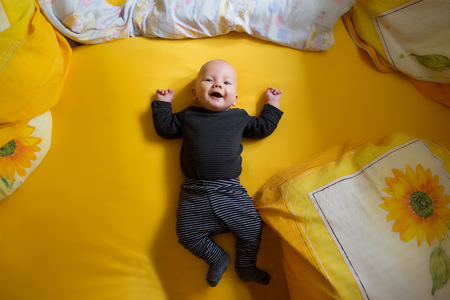 0 6 months: Cheerful child. At home
