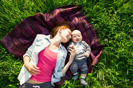 3 6 months: Baby and mother on nature in the park