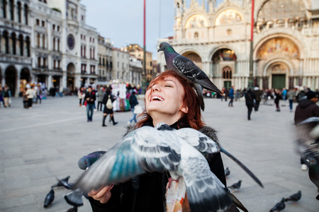 four person only: Happy tourist on the background Saint Marks square, Venice, Italy. Stock Photo