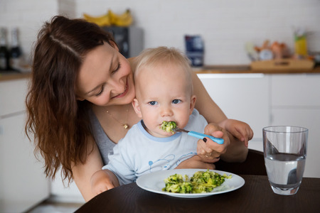 reluctance: Mother with her child eating together and have a fun
