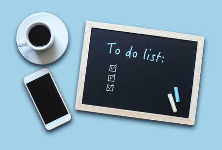 business class travel: Chalkboard or Blackboard concept  with empty To Do List with coffee and mobile phone.