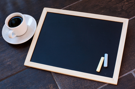 employment elementary school: Chalkboard or Blackboard ready for text. Education or working concept. Stylish office background with coffee and mobile phone. Stock Photo
