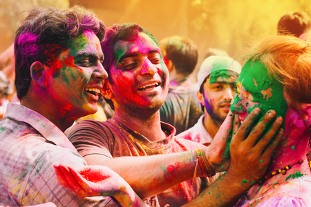 DELHI, INDIA - MARCH 20: Tourists and students of Jawaharlal Nehru University celebrate festival Holi on March 20, 2011 in Delhi, India. Holi is a spring festival celebrated as a festival of colours.
