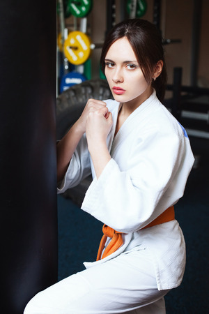 viet vo dao: Beautiful young girl in a kimono. The concept of martial arts, karate, sports, lifestyle, fitness, healthy.