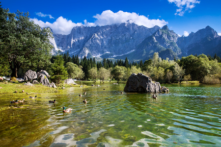 Lago di Fusine lake with Mangart mountains in the background. Udine, Italy, Europe.