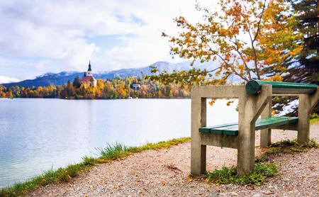 karavanke: View On Bled Lake. Autumn in Slovenia, Europe. View on Island with Catholic Church in Bled Lake with Autumn Forest and Mountains in Background.