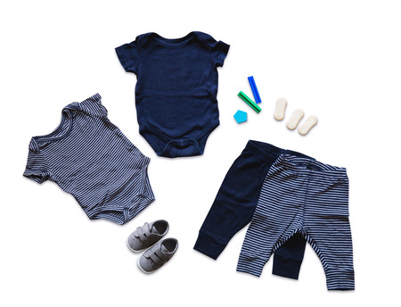 children clothing: Baby clothes, concept of child fashion. Flat lay childrens clothing and accessories. Baby template background with copy space. Top view fashion trendy look of baby clothes and toy stuff. Stock Photo