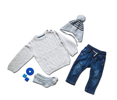 stuff toy: Baby clothes, concept of child fashion. Flat lay childrens clothing and accessories. Baby template background with copy space. Top view fashion trendy look of baby clothes and toy stuff. Stock Photo
