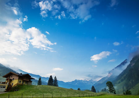 Morning at dawn in the Alps, Austria, Rauris. Amazing view on alpine village valley and mountains. Nature landscape Stock Photo