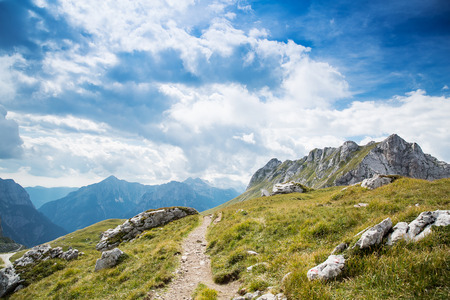 julian: Nature landscape. Amazing view on Alps: valley and mountains at summer. Mangart is a mountain in the Julian Alps, located between Italy and Slovenia.