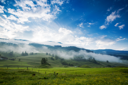 rauris: Morning at dawn in the Alps, Austria, Rauris. Amazing view on alpine village valley and mountains. Nature landscape Stock Photo