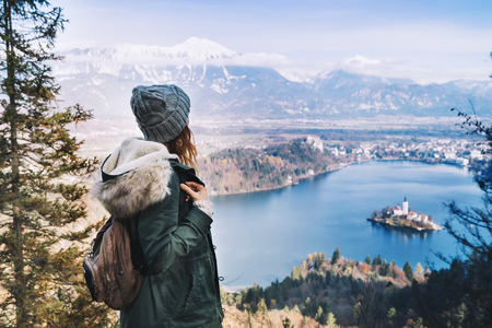 karavanke: Hiking young woman with alps mountains and alpine lake on background. Travel Slovenia, Europe. Stock Photo