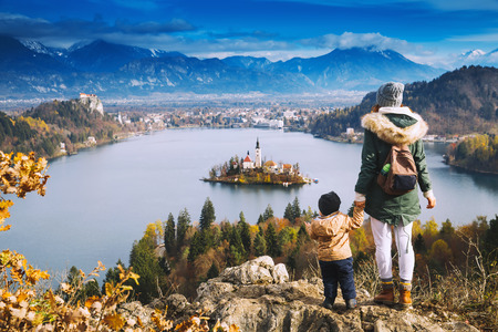karavanke: Family travel Europe. Mother with son looking on Bled Lake. Autumn or Winter in Slovenia, Europe.
