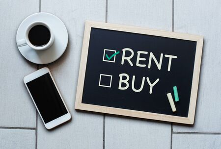 buying questions: Rent not Buy blackboard concept. Choosing renting over buying with coffee and mobile phone