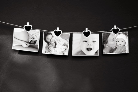 Collage of black and white photos story of a newborn and mother hanging on the clothesline on a textured wall background. Family, new life concept background.