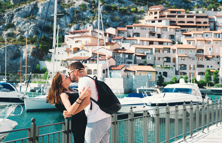 trieste: Beautiful kissing couple in love walking in Portopiccolo Sistiana, Italy, Europe. Lifestyle, Holidays and Travel Concept. Stock Photo