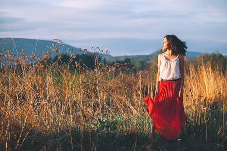 Beauty in Nature. Portrait of young beautiful woman on natural background of meadow. Summer girl on nature.