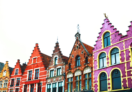 Famous colorful brick houses on the Grote Markt square in the medieval old town of Bruges, Belgium, Europe. Belgian traditional architecture.