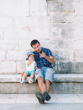 Father and son in Zadar, Croatia. Summer holidays on the seacoast of Europe. Tourists walking on the old historical streets of Zadar. Lifestyles, Family, Vacation and Travel concept. Reklamní fotografie