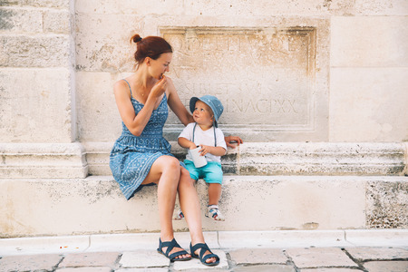 Mother and son in Zadar, Croatia. Summer holidays on the seacoast of Europe. Tourists walking on the old historical streets of Zadar. Lifestyles, Family, Vacation and Travel concept.
