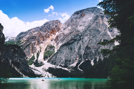 Braies Lake (Lago Di Braies) at summer. Largest natural lake in Dolomites, South Tyrol, Italy, Europe. Beauty of nature background. Famous italian mountain lake is popular photographers attraction