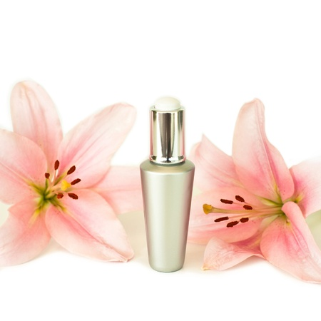 beauty still life with facial cream and flowers Imagens