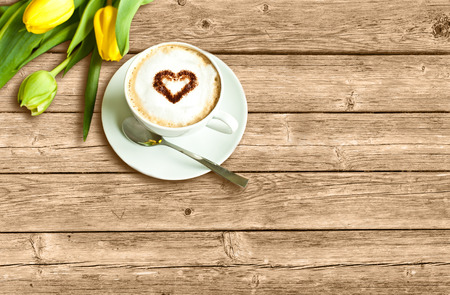 morning coffee: Card with cup of coffee and yellow tulips
