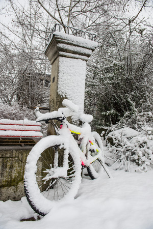 space weather tire: Bicycle covered in snow Stock Photo