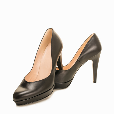 Black high heel women shoes isolated on white Imagens