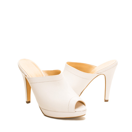 opentoe: Stylish white leather shoes with open toes Stock Photo