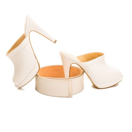 Stylish white leather shoes with open toes and white belt