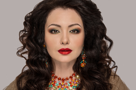 Portrait of Beautiful Woman with Colorful Makeup and Jewels